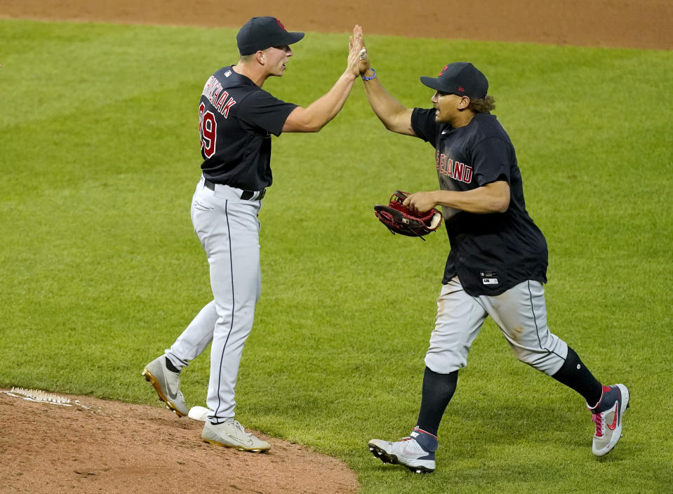 Cleveland Indians relief pitcher James Karinchak, left, and Josh Naylor celebrate after their baseball game against the Kansas City Royals Wednesday, May 5, 2021, in Kansas City, Mo. The Indians won 5-4. (AP Photo/Charlie Riedel)