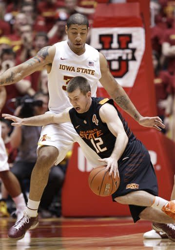 Oklahoma State guard Keiton Page (12) is fouled by Iowa State forward Royce White during the first half of an NCAA college basketball game, Wednesday, Jan. 18, 2012, in Ames, Iowa. (AP Photo/Charlie Neibergall)