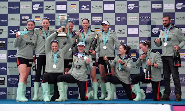 Rowing - 2018 Oxford University vs Cambridge University Boat Race - London, Britain - March 24, 2018 Cambridge women's pose as they celebrate winning the boat race with the trophy REUTERS/Toby Melville