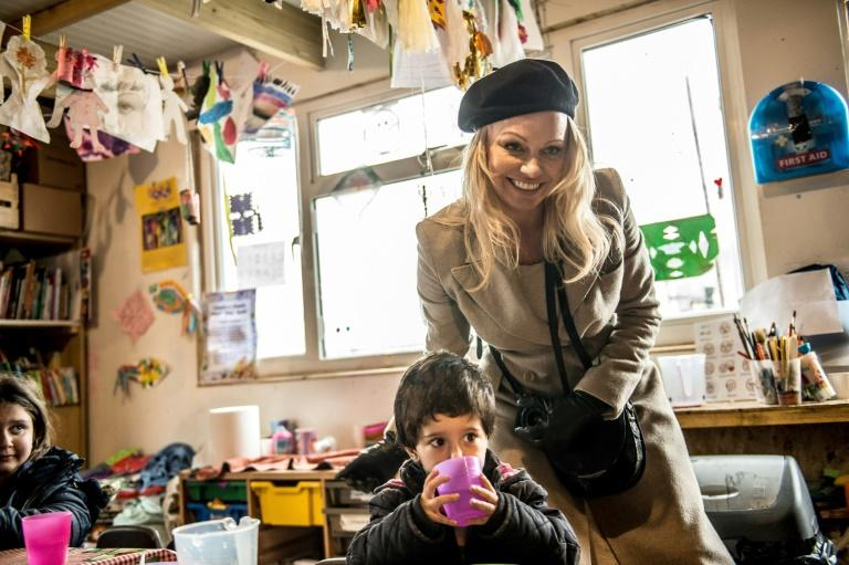 Actress and model Pamela Anderson has been working to help refugee children and other youngsters in need
