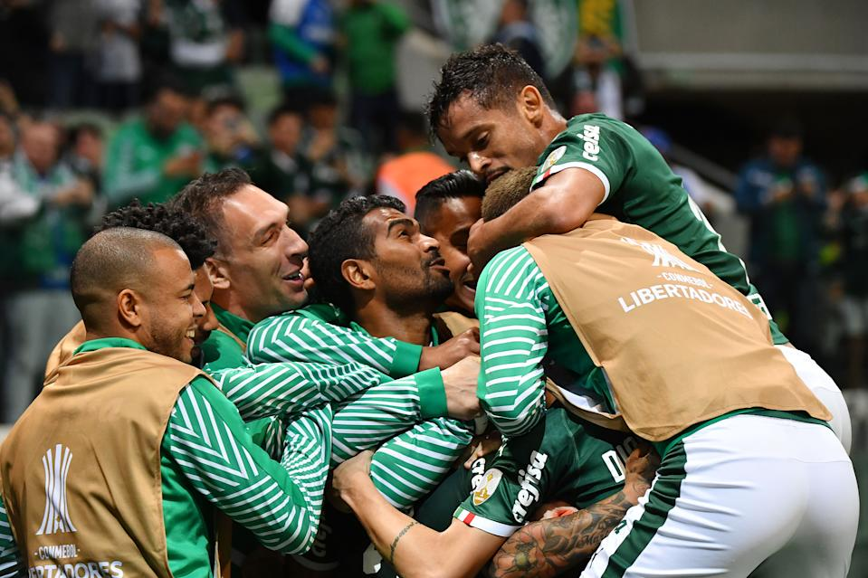 Brazil's Palmeiras players celebrate Dudu's (C, hidden) goal against Argentina's Godoy Cruz during a Copa Libertadores football match held at Allianz Parque stadium, in Sao Paulo, Brazil, on July 30, 2019. (Photo by NELSON ALMEIDA / AFP)        (Photo credit should read NELSON ALMEIDA/AFP/Getty Images)