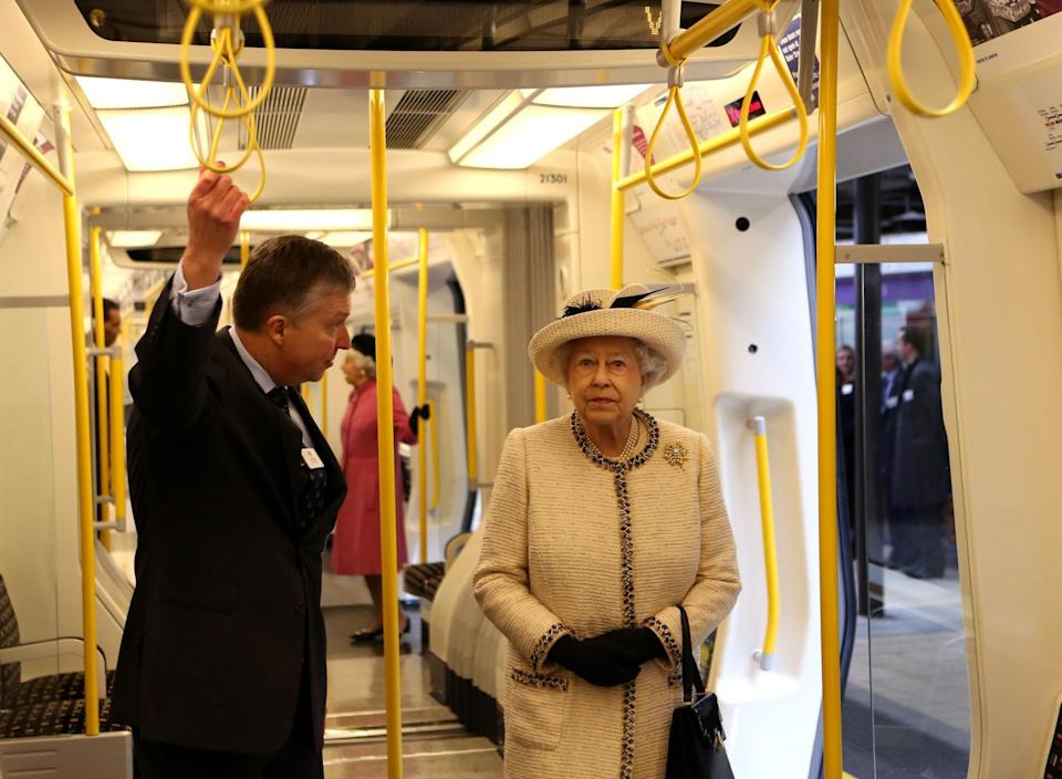 <p>Queen Elizabeth II rides the tube during a visit to Baker Street Tube Station to mark 150th anniversary of the London Underground. (PA) </p>