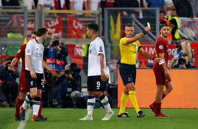 Soccer Football - Champions League Semi Final Second Leg - AS Roma v Liverpool - Stadio Olimpico, Rome, Italy - May 2, 2018 Referee Damir Skomina shows a yellow card to Liverpool's Andrew Robertson REUTERS/Tony Gentile
