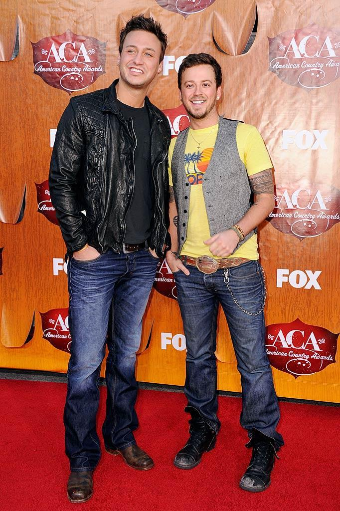 Eric Gunderson (left) and Stephen Barker Liles of Love & Theft arrive at the American Country Awards held at the MGM Grand Garden Arena in Las Vegas. (12/05/2011)