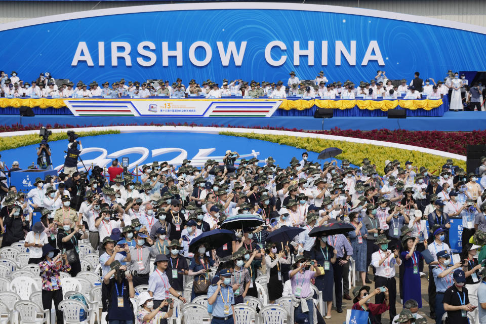 Visitors watch an airshow during the 13th China International Aviation and Aerospace Exhibition, also known as Airshow China 2021, on Tuesday, Sept. 28, 2021, in Zhuhai in southern China's Guangdong province. (AP Photo/Ng Han Guan)