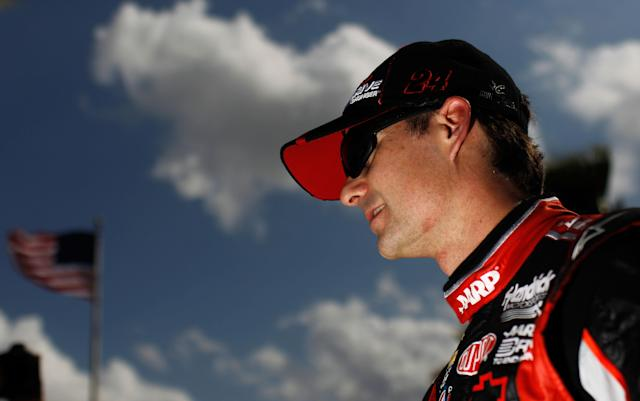 DAYTONA BEACH, FL - FEBRUARY 19: Jeff Gordon, driver of the #24 Drive to End Hunger Chevrolet, looks on during qualifying for the NASCAR Sprint Cup Series Daytona 500 at Daytona International Speedway on February 19, 2012 in Daytona Beach, Florida. (Photo by Tom Pennington/Getty Images for NASCAR)