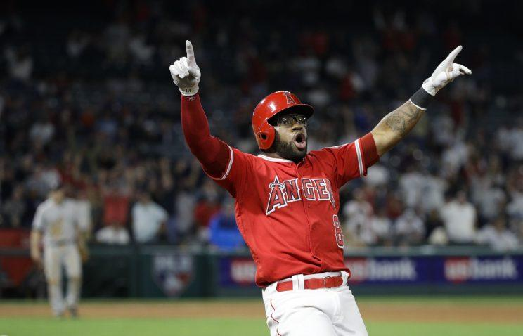 Los Angeles Angels' Eric Young Jr. celebrates his game-winning single during the 11th inning of a baseball game against the New York Yankees, Tuesday, June 13, 2017, in Anaheim, Calif. The Angels won 3-2 in the 11th inning. (AP Photo/Jae C. Hong)