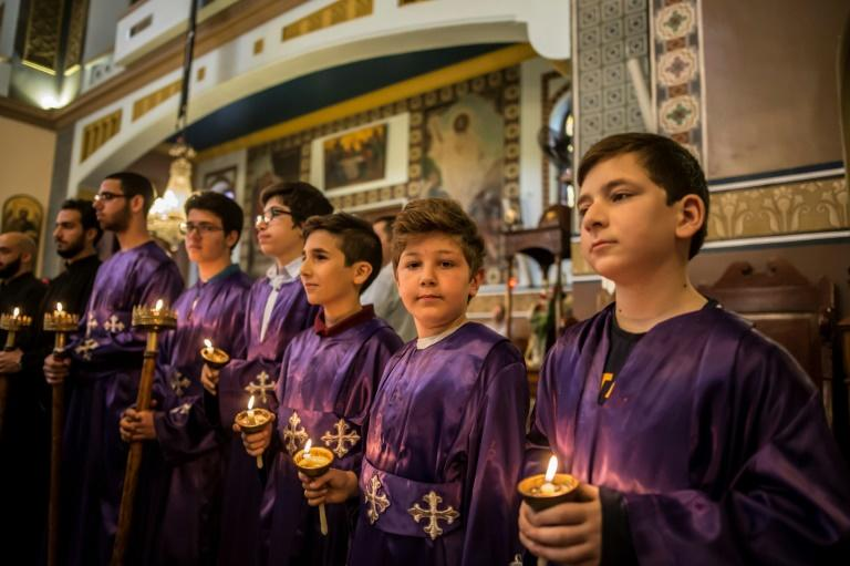 Egyptian Christians take part in the Good Friday procession at the Arch Angels Greek Orthodox Church in the capital Cairo, on April 14, 2017