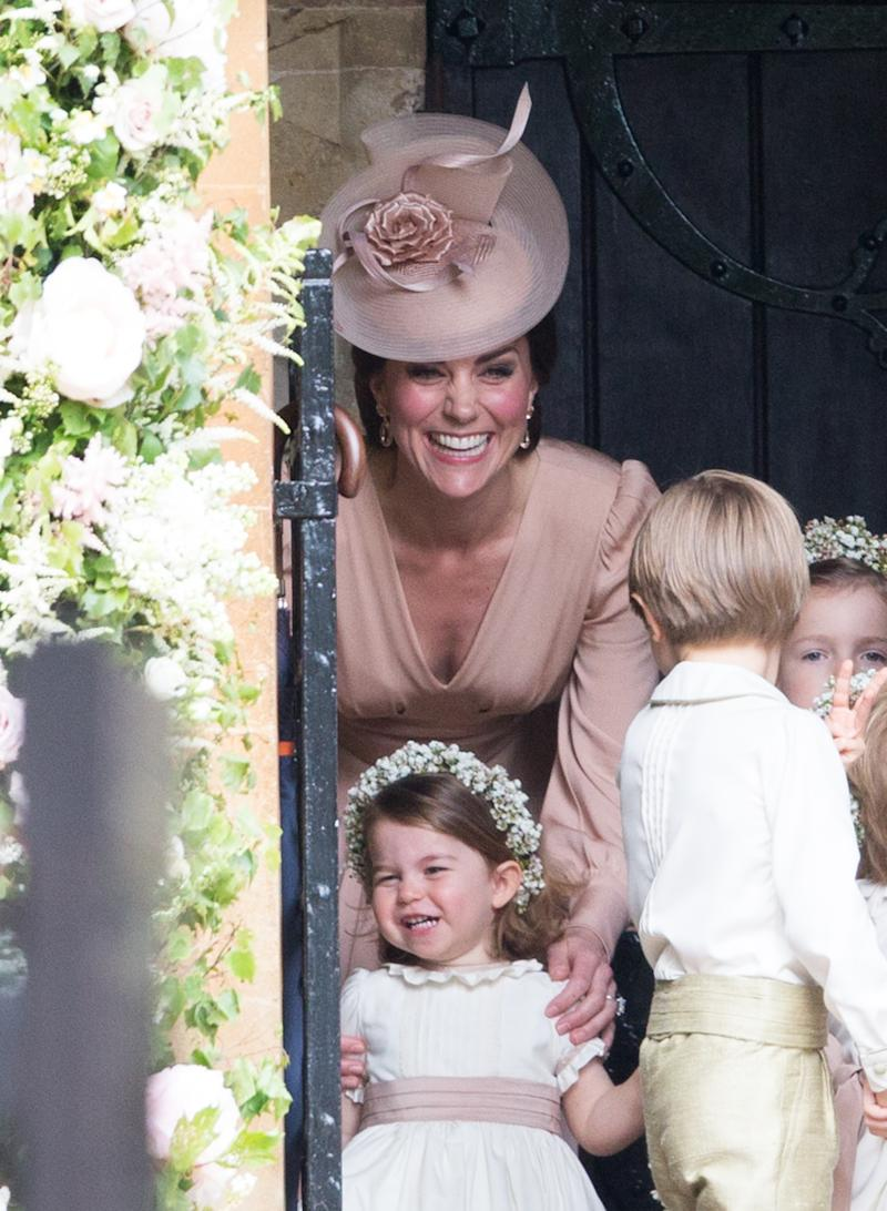 ENGLEFIELD GREEN, ENGLAND - MAY 20: Princess Charlotte of Cambridge, bridesmaid and Catherine, Duchess of Cambridge attend for the wedding Of Pippa Middleton and James Matthews as a page boy gestures at St Mark's Church on May 20, 2017 in Englefield Green, England. (Photo by Pool/Samir Hussein/WireImage)