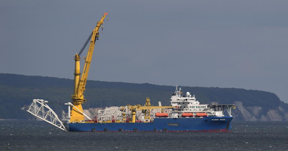 """12 May 2020, Mecklenburg-Western Pomerania, Sassnitz: The Russian laying ship """"Akademik Tscherski"""" lies in front of the chalk cliffs of the island of Rügen. Barely five months after the construction stop on the Nord Stream 2 Baltic Sea pipeline, the Russian pipe-laying ship has reached the Baltic Sea off the island of Rügen. Photo: Stefan Sauer/dpa-Zentralbild/dpa (Photo by Stefan Sauer/picture alliance via Getty Images)"""
