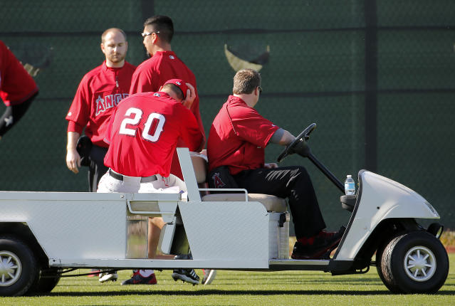 Los Angeles Angels pitcher Mark Mulder is carted off the field after hurting his ankle during the Angels first spring training baseball practice, Saturday, Feb. 15, 2014, in Tempe, Ariz. (AP Photo/Matt York)