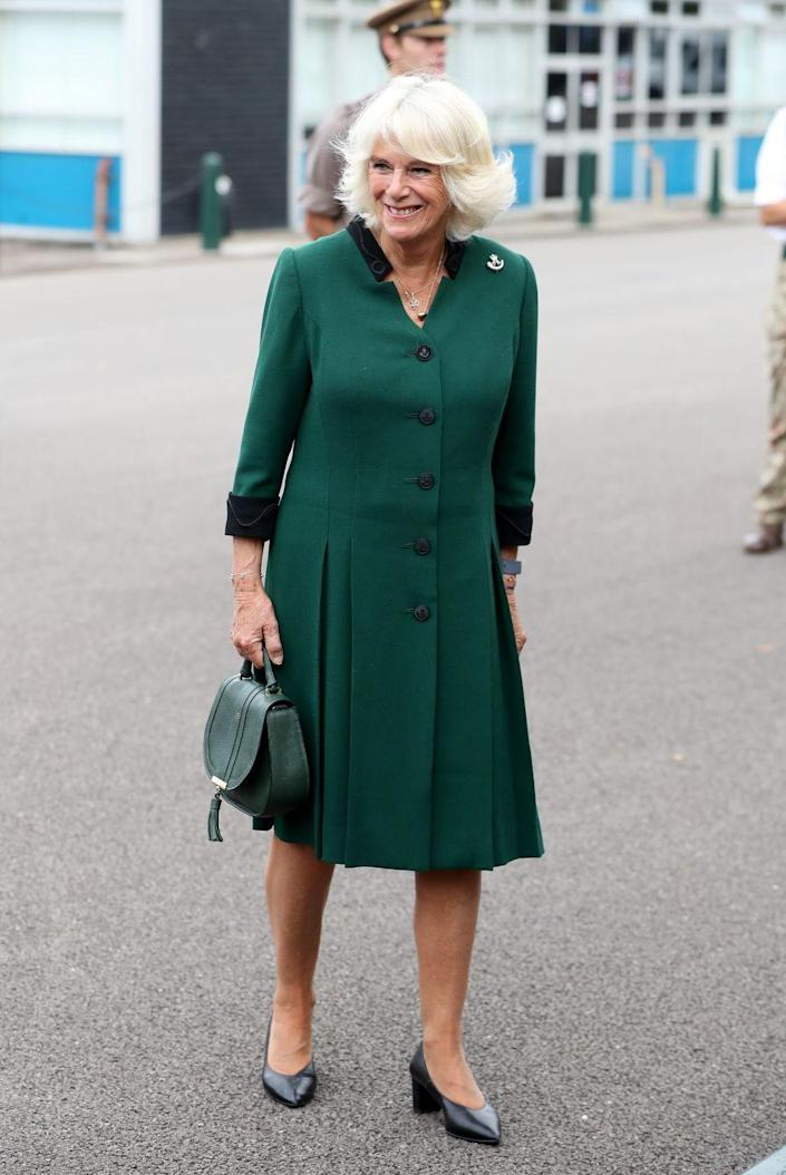 <p>The Duchess of Cornwall went for an all-green look while visiting the Army troops at Beachley Barracks in Gloucestershire. The Duchess previously wore this coat-dress during her February trip to Leicestershire. </p>