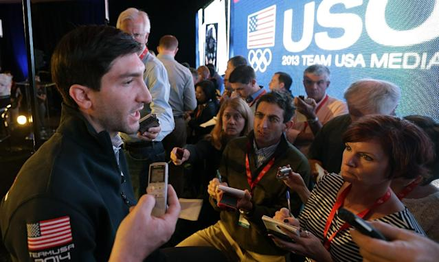 Olympic figure skating champion Evan Lysacek makes remarks during a press conference during the USOC 2013 team USA media summit Monday, Sept. 30, 2013, in Park City, in Utah. Lysacek has a torn labrum, and will miss next month's Skate America. Lysacek was initially diagnosed with an abdominal tear after a fall in August. But he says he continued to feel pain, and further tests revealed the tear. (AP Photo/Rick Bowmer)