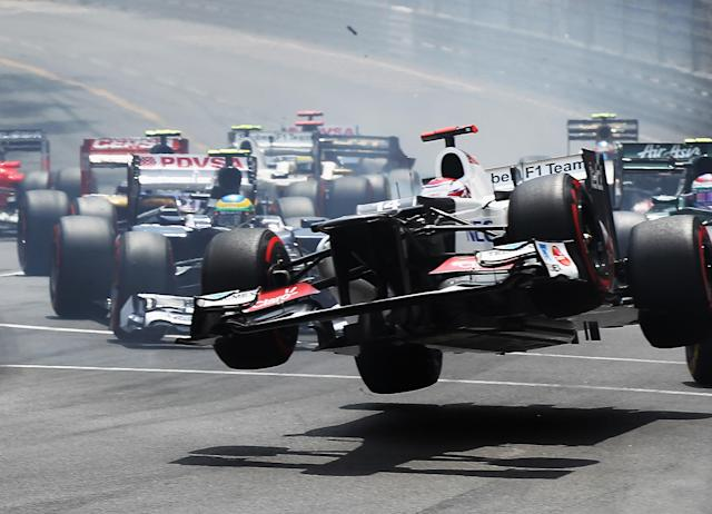 MONTE CARLO, MONACO - MAY 27: Kamui Kobayashi of Japan and Sauber F1 touches wheels with the spinning Romain Grosjean (out of frame) of France and Lotus at the start of the Monaco Formula One Grand Prix at the Circuit de Monaco on May 27, 2012 in Monte Carlo, Monaco. (Photo by Mark Thompson/Getty Images)