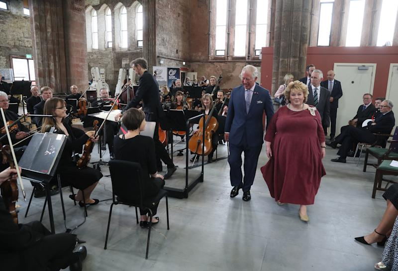 BELFAST, NORTHERN IRELAND - JUNE 12: Prince Charles, Prince of Wales and Fionnuala Jay-O'Boyle, founder of the Belfast Buildings Trust, meet members of the Ulster Orchestra during his visit to Carlisle Memorial Church on June 12, 2018 in Belfast, Northern Ireland. (Photo by Brian Lawless - WPA Pool/Getty Images)