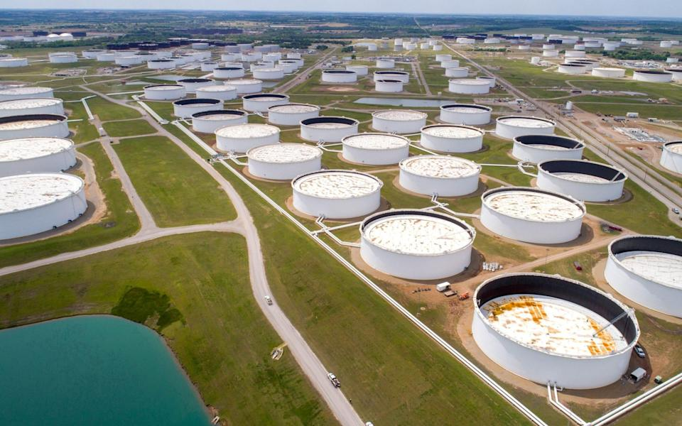 Crude oil storage tanks are seen in an aerial photograph at the Cushing oil hub in Cushing, Oklahoma - Dronebase/REUTERS