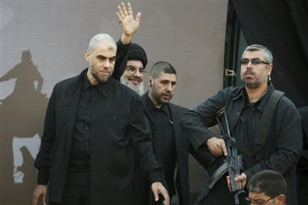 Lebanon's Hezbollah leader Sayyed Hassan Nasrallah greets his supporters during a religious procession to mark Ashura in Beirut's suburbs November 14, 2013. REUTERS/Khalil Hassan