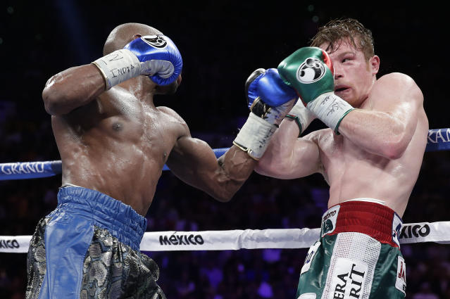 Floyd Mayweather Jr. jabs at Canelo Alvarez ageinst the ropes in the tenth round during a 152-pound title fight, Saturday, Sept. 14, 2013, in Las Vegas. (AP Photo/Eric Jamison)