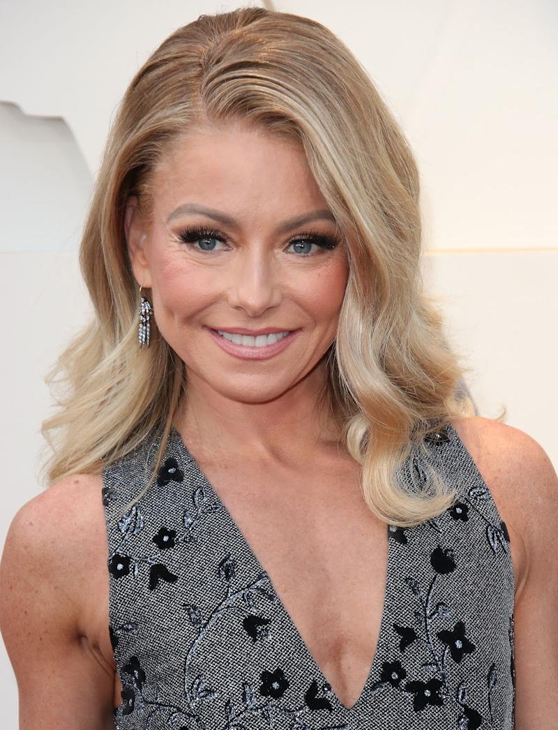 Kelly Ripa smiles in a sleeveless dress