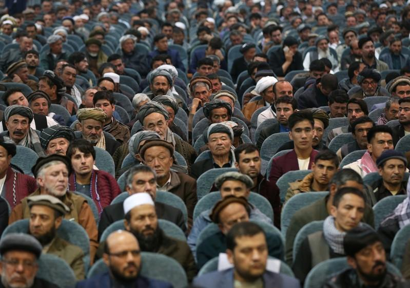 Supporters of presidential candidate Abdullah Abdullah attend a gathering in Kabul