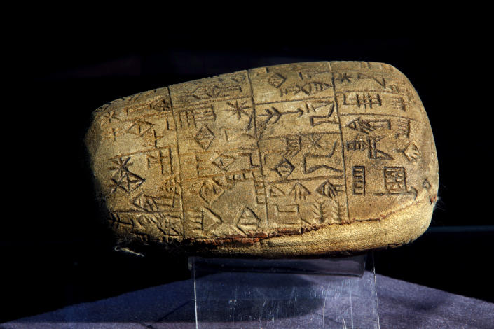 A recovered cuneiform era stone is displayed at the Iraqi National Museum in Baghdad, Iraq, Monday, April 1, 2013. Tens of thousands of artifacts chronicling some 7,000 years of civilization in Mesopotamia are believed to have been looted from Iraq in the chaos which followed the the US-led invasion in 2003. Despite international efforts to track items down, fewer than half of the artifacts have so far been retrieved. (AP Photo/Hadi Mizban)