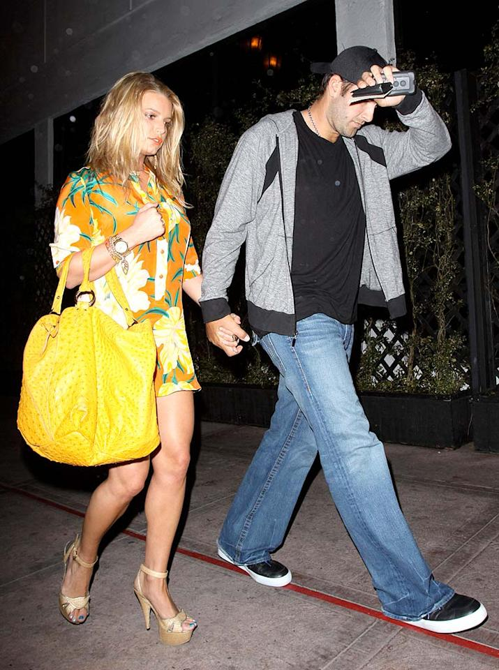 """The former chart-topping songstress and her main squeeze don't seem too pleased with the flashing cameras. <a href=""""http://www.x17online.com"""" target=""""new"""">X17 Online</a> - April 11, 2009"""