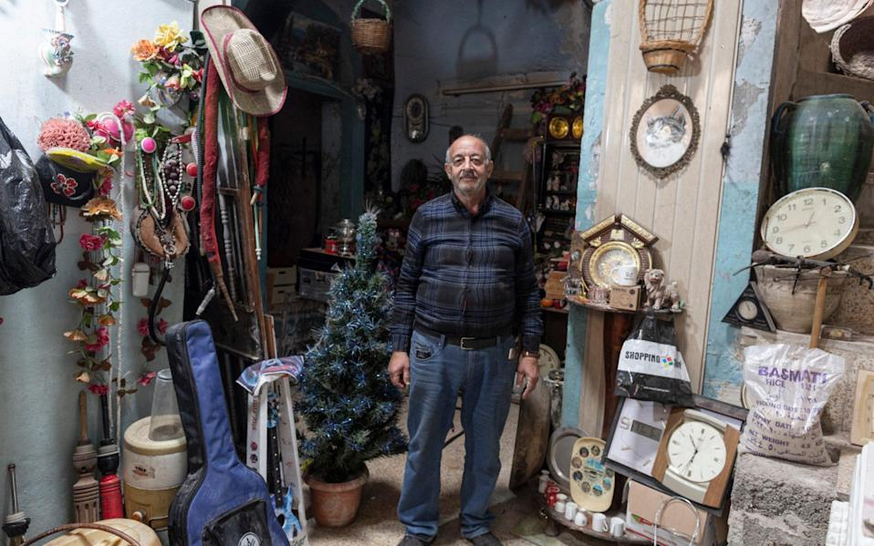 Saadullah Rassam, 63, who claims to be the only Christian currently living in the Old City of Mosul, is photographed inside his house adjacent to The Immaculate Syriac Catholic Church, in Mosul - Sam Tarling for the Telegraph