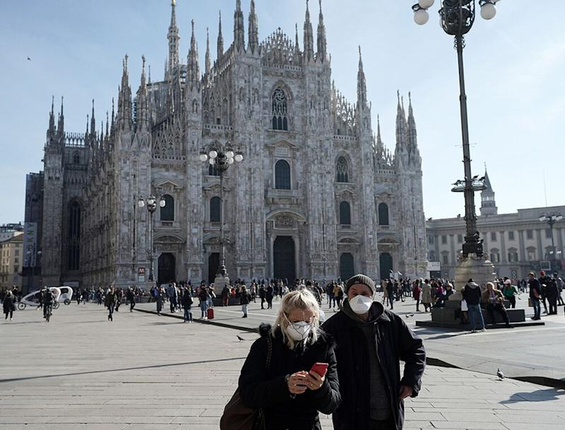 Tourists wear face masks in Milan | Stefania D'Alessandro/Getty