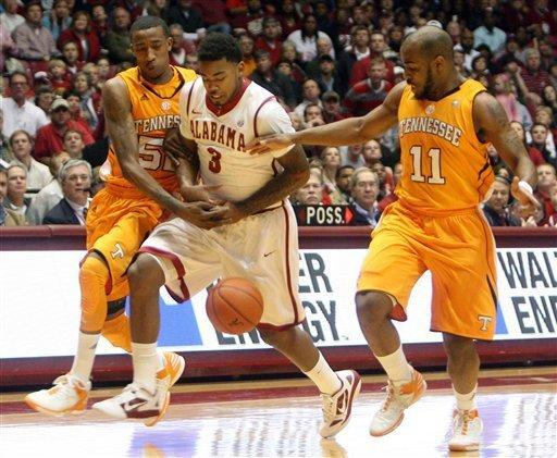 Tennessee's Jordan McRae (52) and Trae Golden (11) go for the ball along with Alabama guard Trevor Lacey (3) during the first half of a game of an NCAA college basketball game in Tuscaloosa, Ala., Saturday, Feb. 18, 2012 (AP Photo/The Tuscaloosa News, Michelle Lepianka Carter)