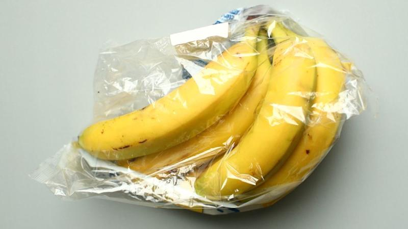 Bananas, wrapped in a plastic as bought in a supermarket
