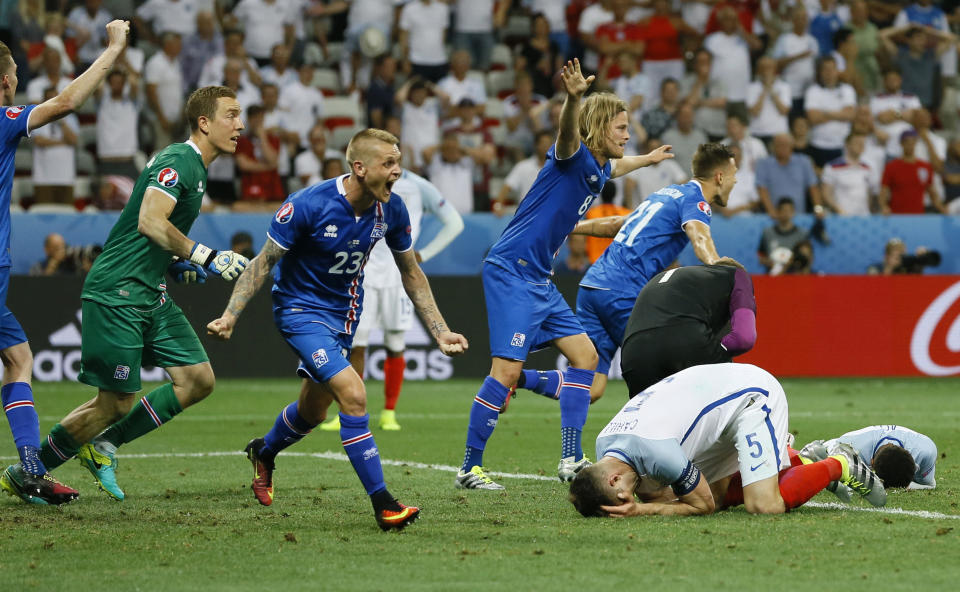 FILE - In this June 27, 2016 file photo Iceland players celebrate winning at the end of the Euro 2016 round of 16 soccer match between England and Iceland, at the Allianz Riviera stadium in Nice, France. (AP Photo/Kirsty Wigglesworth, File)
