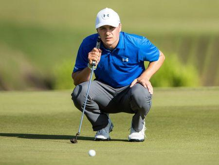 Apr 27, 2017; Avondale, LA, USA; Jordan Spieth lines up a putt on the 18th hole during the first round of the Zurich Classic of New Orleans golf tournament  at TPC Louisiana. Mandatory Credit: Stephen Lew-USA TODAY Sports