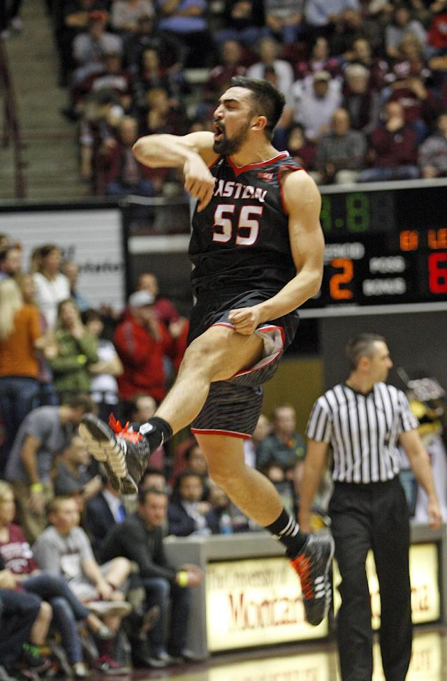 Eastern Washington forward Venky Jois (55) celebrates during the closing seconds of an NCAA college basketball game against Montana in the Big Sky Conference Tournament championship in Missoula, Mont., Saturday, March 14, 2015. (AP Photos/Michael Albans)