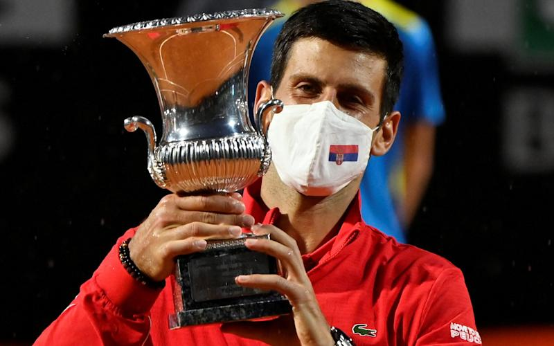 Novak Djokovic celebrates with the trophy after winning the final against Diego Schwartzman - REUTERS