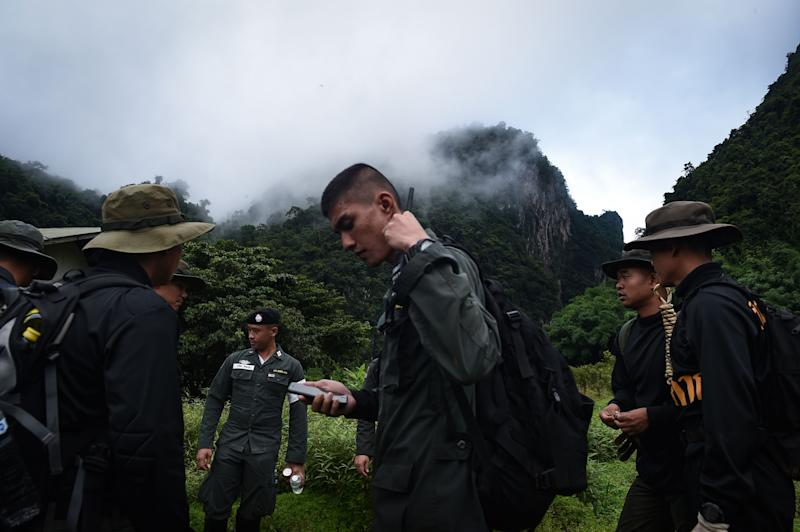 Thai soldiers and police gather in the mountains near the Tham Luang cave at the Khun Nam Nang Non Forest Park in Chiang Rai province on June 30, 2018 as the rescue operation continues for the children of a football team and their coach.