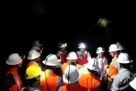Continental Gold project workers hold a meeting inside the Continental Gold mine in Buritica