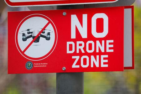 A sign at a downtown city park informs people the area is a no drone zone in San Diego, California