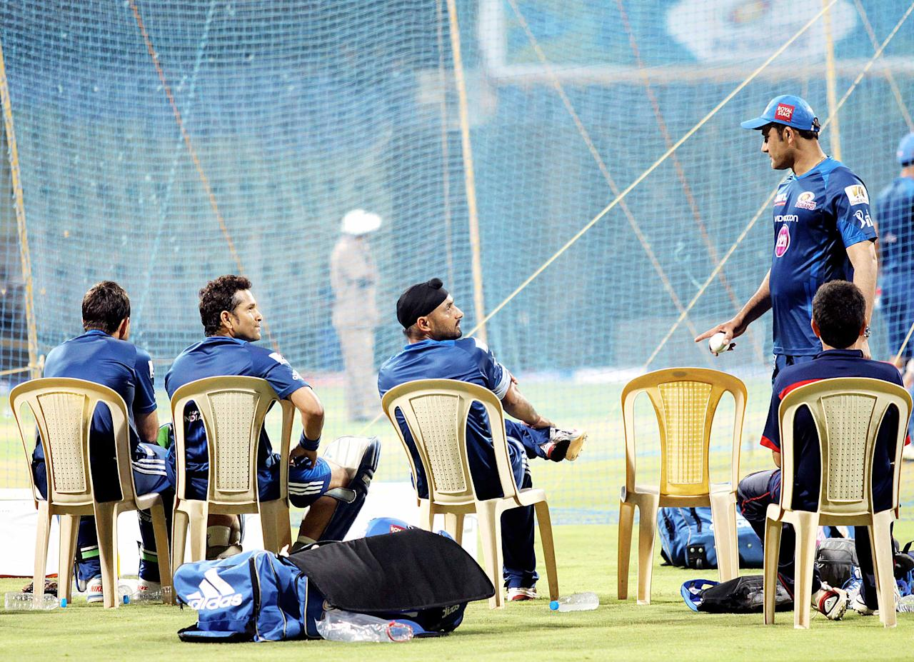 Mumbai Indians chief mentor Anil Kumble has a word with Harbhajan Singh as Sachin Tendulkar looks on during a nets session. (Yogen Shah)
