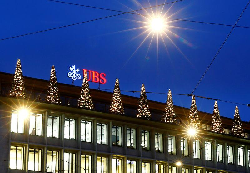 FILE PHOTO: Christmas decorations are seen at the building of Swiss bank UBS in Zurich