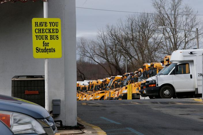 Red Clay School District buses sit in a bus yard in New Castle.