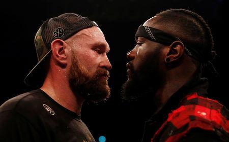 FILE PHOTO: Boxing - Tyson Fury v Francesco Pianeta - Windsor Park, Belfast, Britain - August 18, 2018. Tyson Fury and Deontay Wilder in the ring after the fight. Action Images via Reuters/Lee Smith/File Photo