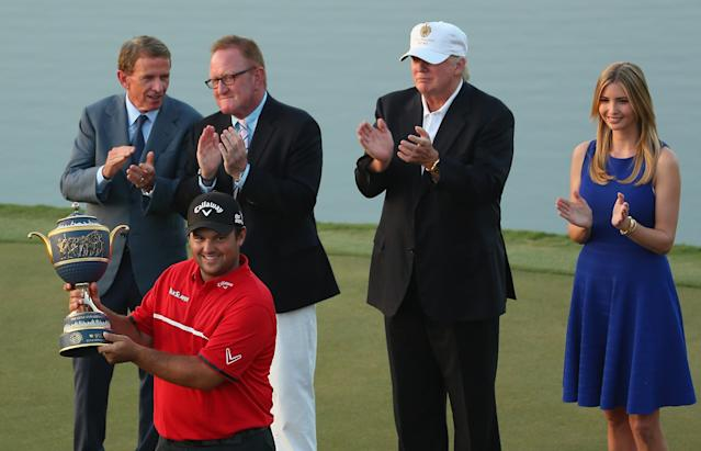 DORAL, FL - MARCH 09: Patrick Reed celebrates with the Gene Sarazen Cup after his victory as PGA Tour Commissioner Tim Finchem, Richard Hills of the European Tour, Donald Trump and Ivanka Trump look on during the final round of the World Golf Championships-Cadillac Championship at Trump National Doral on March 9, 2014 in Doral, Florida. (Photo by Mike Ehrmann/Getty Images)