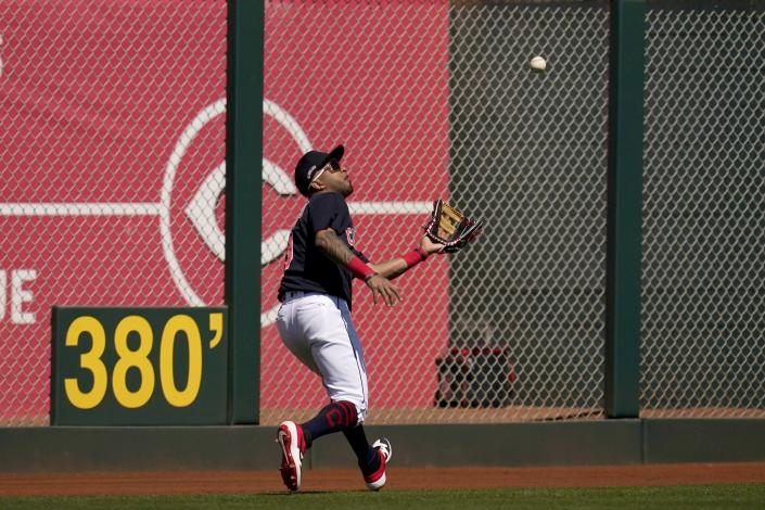 Cleveland Indians left fielder Eddie Rosario reaches out to make a catch on a fly ball hit by Los Angeles Angels' Matt Thaiss during the second inning of a spring training baseball game Wednesday, March 10, 2021, in Goodyear, Ariz. (AP Photo/Ross D. Franklin)
