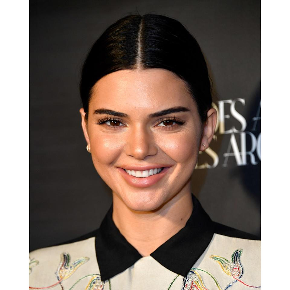 Kendall Jenner letting those signature features (brows, cheekbones, eyes) and a taupe pink lip take centerstage.