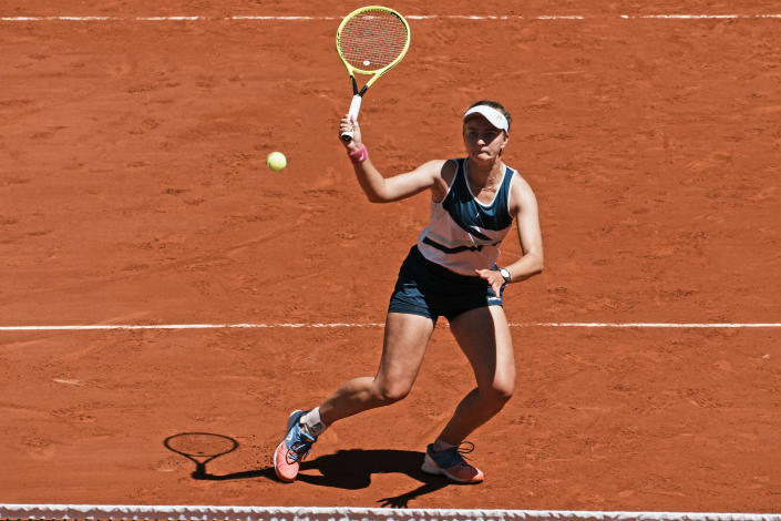 Czech Republic's Barbora Krejcikova volleys the ball as she plays with compatriot Katerina Siniakova again USA's Bethanie Mattek-Sands and Poland's Iga Swiatek during their women's doubles final match of the French Open tennis tournament at the Roland Garros stadium Sunday, June 13, 2021 in Paris. (AP Photo/Thibault Camus)