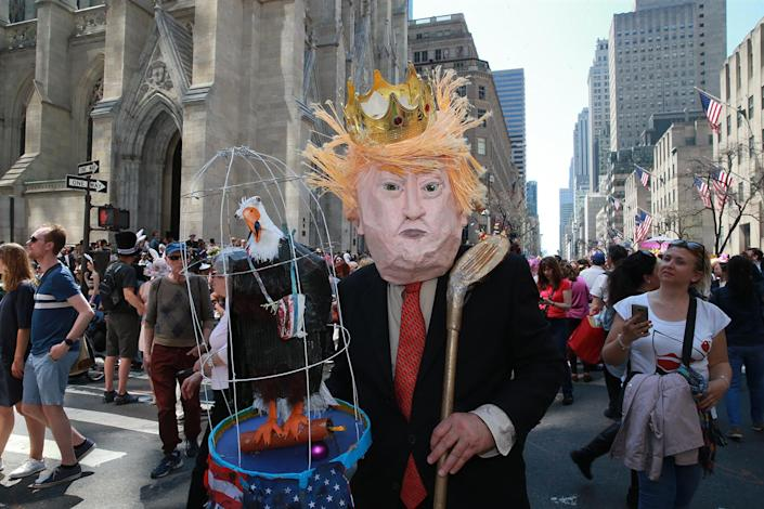 <p>A demonstrator dressed as Donald Trump poses for photos during the annual Easter Parade and Easter Bonnet Festival on the Fifth Avenue in New York on April 16, 2017. (Photo: Gordon Donovan/Yahoo News) </p>