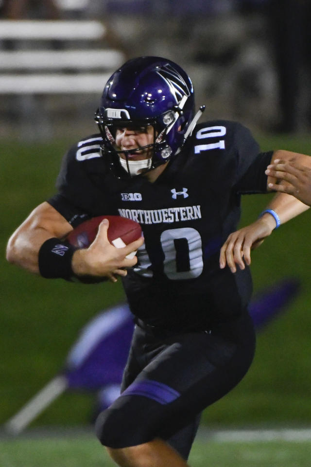 FILE - In this Sept. 15, 2018, file photo, Northwestern quarterback TJ Green (10) runs against Akron during the second half of an NCAA college football game in Evanston, Ill. As he listened to his teams introduction during last months Big Ten Kickoff Luncheon, Northwestern coach Pat Fitzgerald was a bit stunned by what he heard. Clayton Thorson leaves as the winningest quarterback in Northwestern history, the Big Ten Networks Rick Pizzo said, reading from a script. But hell be replaced by five-star Clemson transfer Hunter Johnson. That was news to Fitzgerald, who said the competition for starting quarterback at the beginning of fall camp was wide open with Hunter, senior TJ Green and junior Aidan Smith being the main contenders. (AP Photo/Matt Marton)