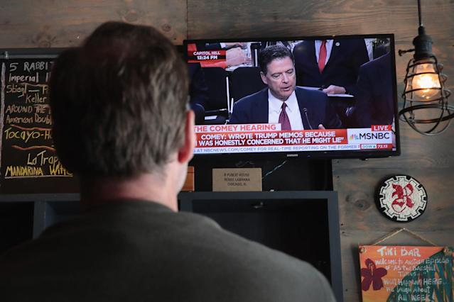 <p>Customers at R Public House watch as former FBI Director James Comey testifies before the Senate intelligence committee on June 8, 2017 in Chicago, Illinois. (Scott Olson/Getty Images) </p>