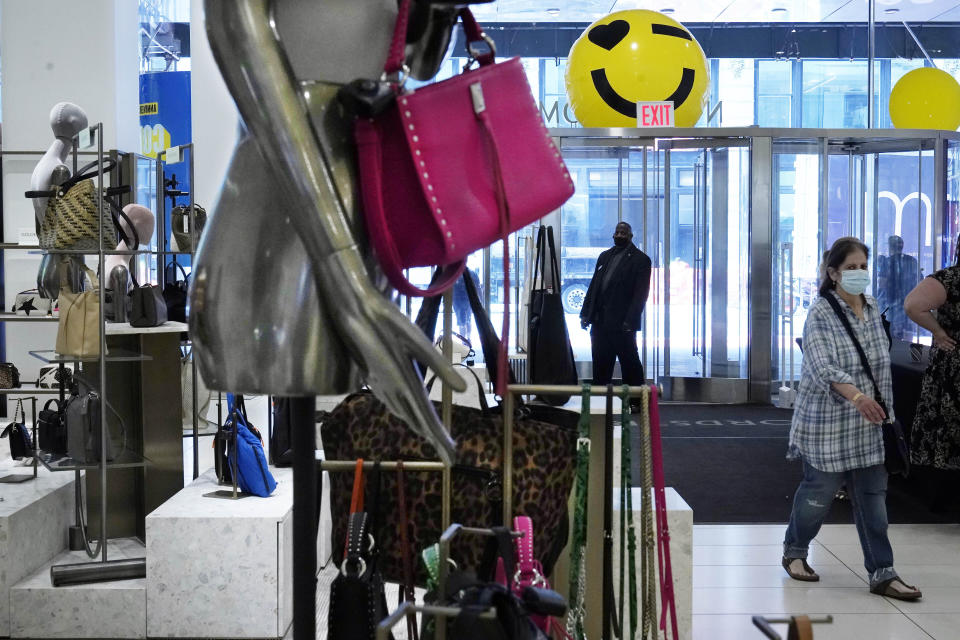 A woman shops at the Nordstrom NYC Flagship store, in New York, Wednesday, July 14, 2021. Like many of its peers, venerable department store chain Nordstrom is having a tough time keeping pace with customer demand for new clothes because of supply issues. (AP Photo/Richard Drew)