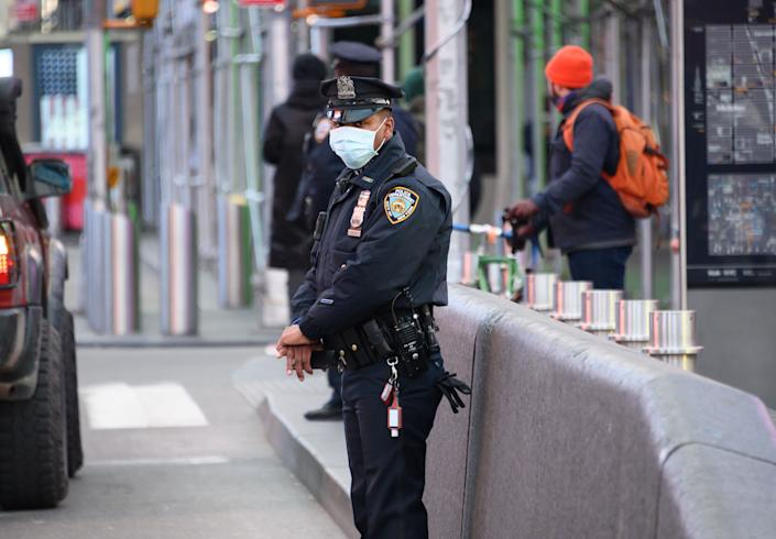 An NYPD police officer wears a protective face mask in Times Square on March 22. (Photo: Noam Galai via Getty Images)